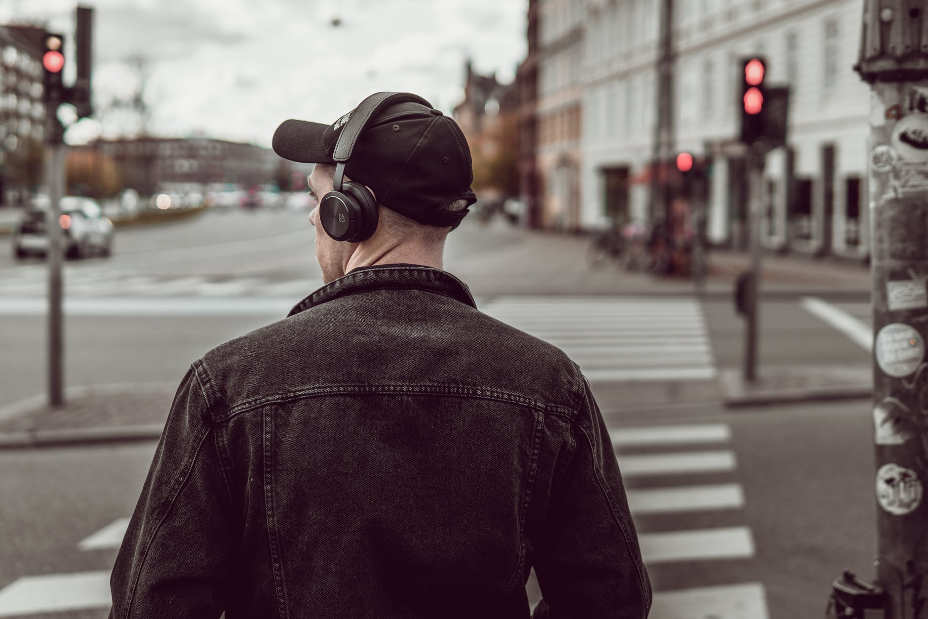 man listening to music on city street